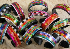 These bracelets boldly make a fashion statement with color and shine.