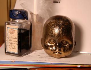 Baby Doll Head Paperweight Mark Montano