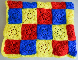 Checkerboard in Primary Colors Stroller blanket, free crochet pattern by Underground Crafter on FaveCrafts Blog